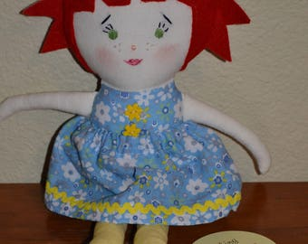 Doll with light blue skirt