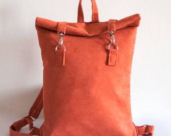Faux suede rolltop backpack with swivel clasps