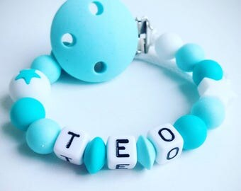 """Personalized pacifier """"Star"""" turquoise and white silicone - model """"Teo"""""""