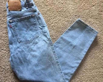 90s vintage Levi's 550 relaxed fit tapered light-wash high-waisted mom jeans