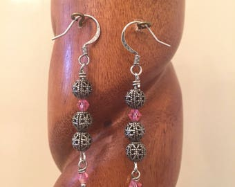 Antique silver dangle earrings with wire wrapped metal filigree and pink Swarovski crystal beads