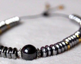 Bracelet, hematite and gold beads