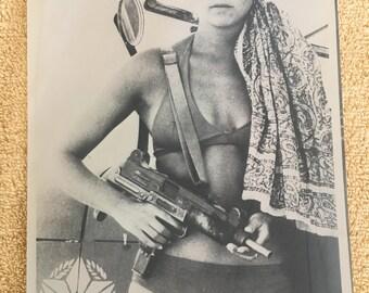 Rebel woman in bikini with Uzi-art shot from 1970s