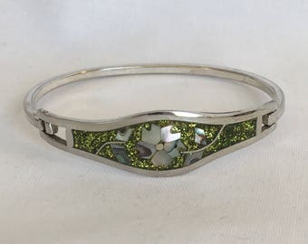 Vintage Taxco Mexico Silver Hinge Bracelet Featuring Green Confetti Enamel With Inlaid Abalone Flowers