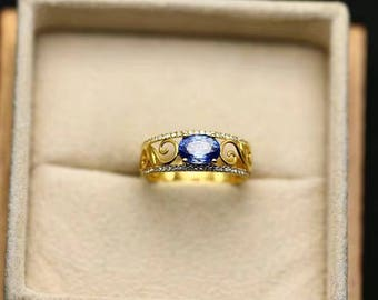 Oval Tanzanite Engagement Ring With Diamond In 14k Yellow Gold