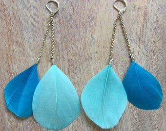 Silver plated blue feather earrings