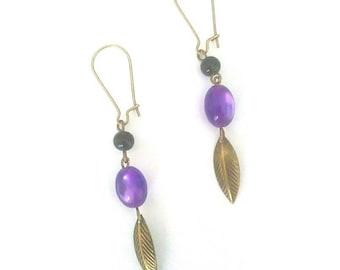 Bouxles on purple and bronze earrings. Leaf.