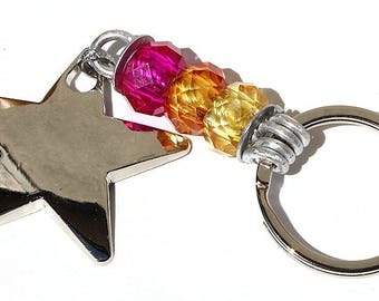 """Keychain with a Silver Star adorned with three colored faceted glass rondelles: """"A star is born"""""""