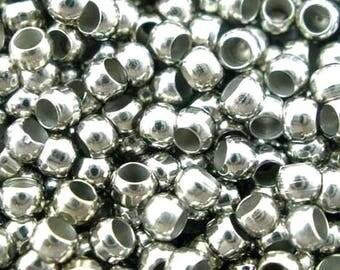 Pack of 2000 beads 2 mm crimp Platinum.
