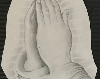Hand drawn praying hands.