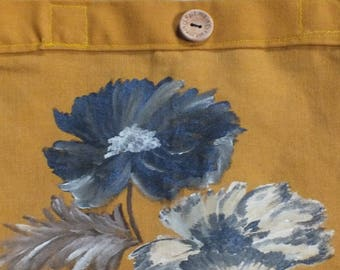 painted mustard fabric bag: large blue flowers.