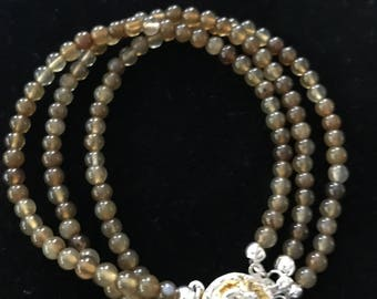 8 inch, Three Strand 6mm Rutile Bead Bracelet with Flower Clasp