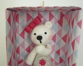 Teddy bear in an origami frame