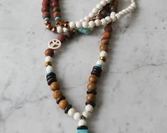 Necklace, turquoise cross pendant necklace and semiprecious stones.