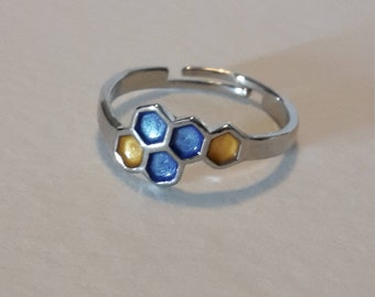 Honeycomb / molecule silver plated ring with blue + honey yellow detail. Jewellery. Adjustable to fit.