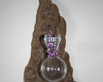 Vase on pine bark, purple thread