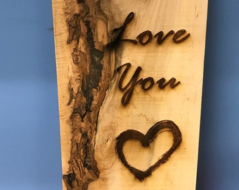 Etched wooden sign