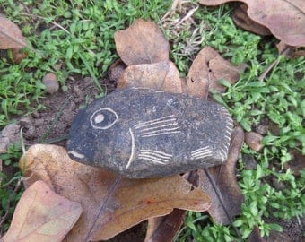 Hand carved black river rock fish