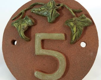 House number with ivy leaves, terracotta plaque