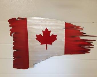 Tattered aluminum Canadian flag