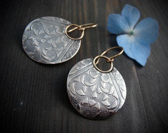 large printed moon ... mixed metal earrings