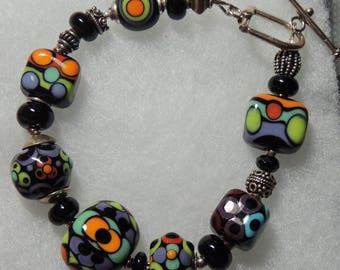 COLOR DOTS on a BLACK Canvass Handmade Lampwork Bead Bracelet