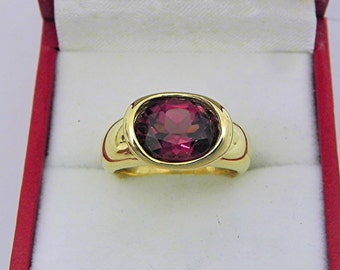 AAAA  Grape Rhodolite Garnet 3.13 carats  10 x 8.3mm in 14K Yellow gold bezel set ring. 0251