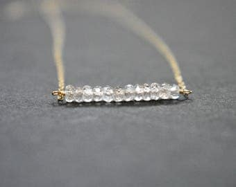 champagne zircon bar necklace on gold filled chain. zircon bar pendant necklace. sparkly zircon gemstone bar necklace. minimalist jewelry