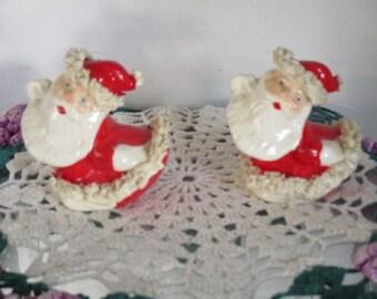 Two Vintage Red with White Spaghetti Trim Santa Claus