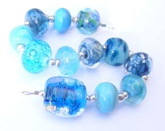 Handmade lampwork glass bead set of 12 mainly aqua renegade beads - lampwork orphan beads
