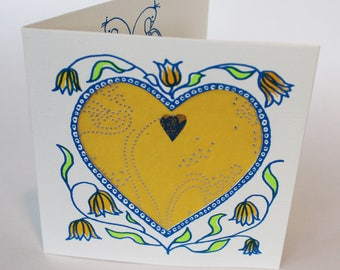 Valentines Card, handprinted with hearts and love birds and yellow and gold decorative paper