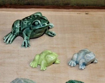 Frogs, small and large. Fit nicely in a planter, terrarium, nook or beta tank. Too cute. Made from 1960's mold.