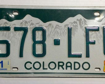 Colorado license plate with green mountains