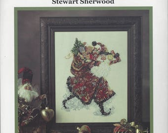 """Clearance-""""Santa's Magical Coat of Colors"""" Counted Cross Stitch by Lavender Wings"""