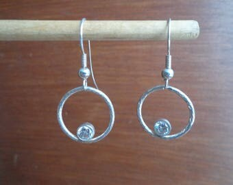 Silver ring earrings with cubic zirconias.
