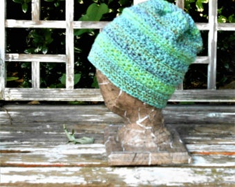 """Unique one of a kind Green sea foam slouchy Star Burst crochet hat. 22"""" around fits teen-small adult or small-medium size."""