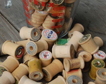 Vintage Wooden Spools. Lot of wooden spools. 4 cups of little wooden spools