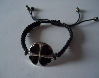 Adjustable Tibetan bracelet with a black clover