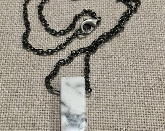 White gray marbled stone necklace on a black chain