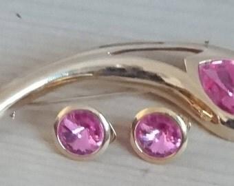 Vintage pink rhinestone brooch and clip on earrings
