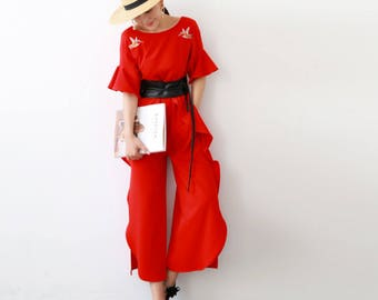 La Chic Parisienne Collection red effortless chic jumpsuit with bird embroidery