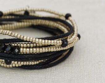Nuovo Braccialetto wrap, Bracciale donna, Gioiello donna, gioiello unisex, gioiello artigianale, bracciale quattro fili, nero e argento