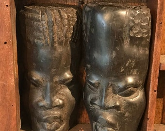 Small African heads made of carved wood