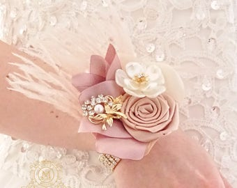 Blush pink feather ostrich corsage, champagne rse gold jeweled wedding bracelet for bridesmaids.