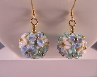 Handmade lampwork glass bead earrings,Floral earrings, Sterling silver earrings,Vermeil 24K. gold-filled,blue,aqua and white raised Flowers.