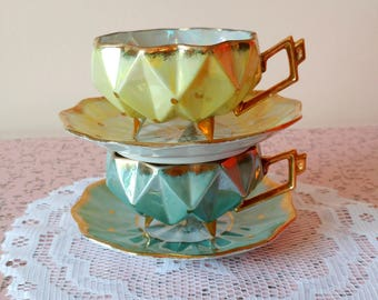Set of 2 vintage Castle tea cups and saucers