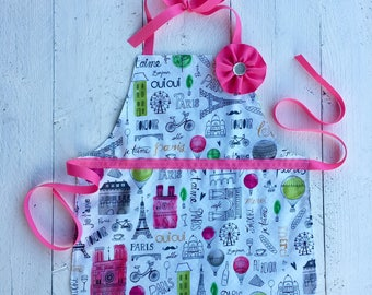 Personalized handmade aprons and fabric party by littlesarasews pink paris reversible polka dot toddler girl apron for kitchen art or play negle Gallery