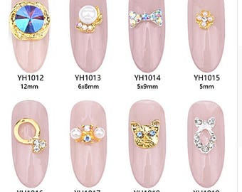 Bow nail art etsy 10pcs gold metal jewelry nail art decoration charms with rhinestones pearl cat design silver bows nail prinsesfo Image collections