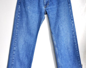 Vintage Levi's 501 blue jeans, Made in USA, Medium wash, Medium to High waist,  Button fly jeans, 80s blue jeans, blue denim jeans