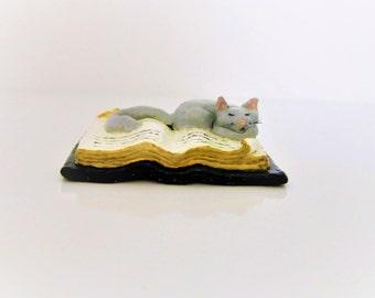 Handmade clay miniature sculpture pencil-holder, hand sculpted & painted, miniature grey cat sculpture sleeping on miniature book sculpture